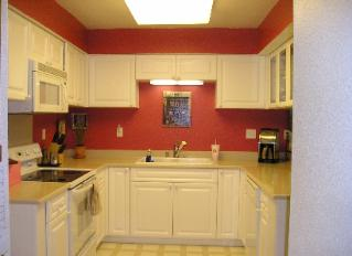 Kitchen with white cabinets and red walls roselawnlutheran for Kitchen ideas white cabinets red walls